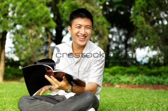man chat and smile with book outdoor