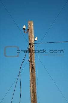 Old broken wooden power line pole
