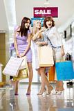 Three girls in shop