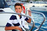 teenager boy sea marina summer vacation in boat