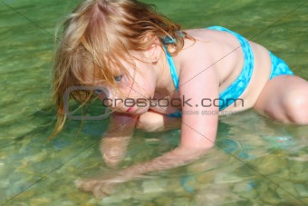 blond girl swimming in lake river