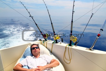 Sailor man fishing resting in boat summer vacation