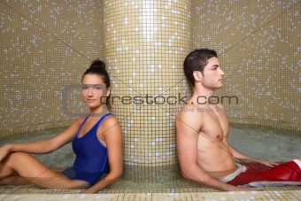 Couple in cool spa water round pool after sauna