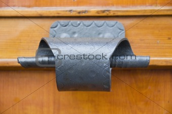 Ancient handle on allwood door.