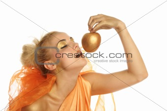 Beautiful woman in gold with gold apple