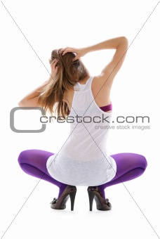 Beautiful woman in violet stockings
