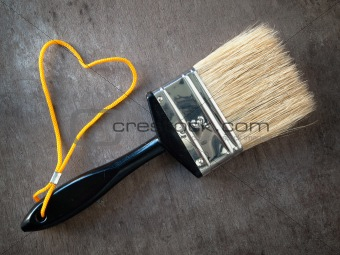 Paint brush with a yellow rope