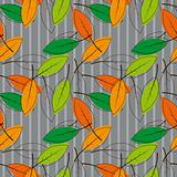 Seamless background with colored leaves