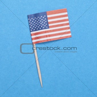 American Flag Toothpick on a Blue Background.