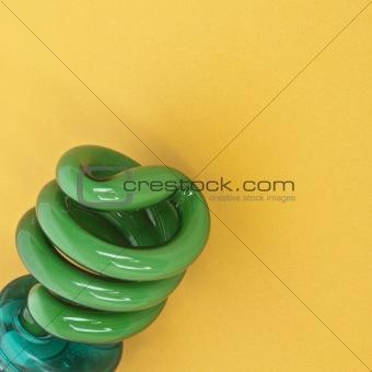 Green Energy Saving Light Bulb on a Vibrant Background