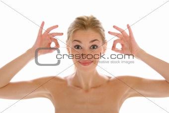Beautiful woman cleans ears wadded sticks