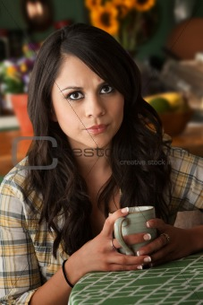 Beautiful Serious Latina Woman with Cofee or Tea