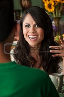 Angry Latina Woman with Cofee or Tea and Male Companion