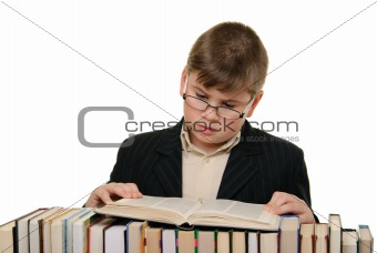 Boy in glasses reads book