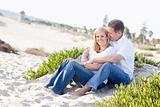 Attractive Caucasian Couple Relaxing and Enjoying the Beach Together.