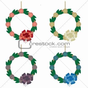 Four holiday wreaths