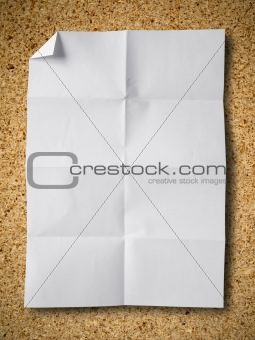 Crumpled paper on Particle board