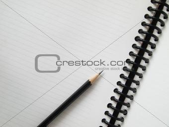 Black pencil on open white paper