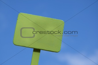 Green Sign on Bright Blue Cloudy Sky