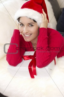 A beautiful sexy girl is smiling holds a gift box