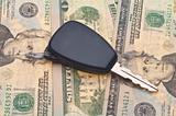 Car Key on Money Background