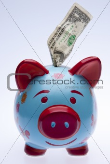 Brightly Colored Piggy Bank with Money