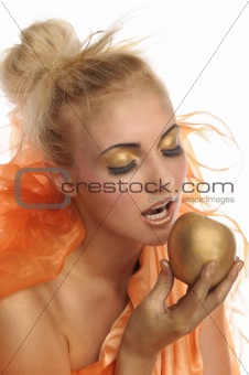 Beautiful woman in gold with apple