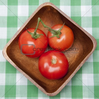 Tomatoes in a Bowl on a Picnic Blanket.