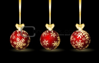 Three red Christmas spheres