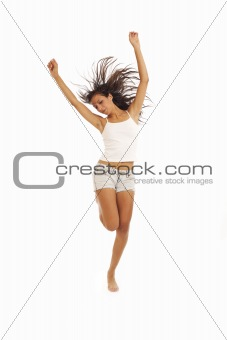 Cute young energetic girl dancing and jumping