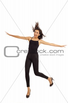 Cute young energetic girl wearing black dancing and jumping