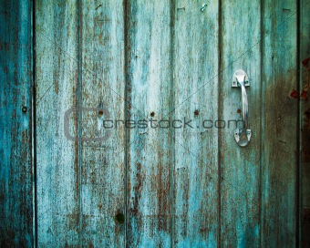 Old Door handle with an old door