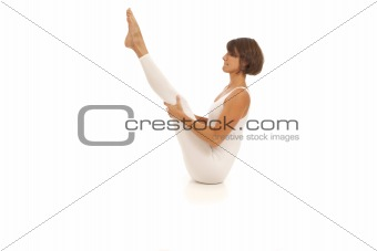 Young woman doing yoga Navasana Boat Pose