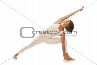 Young woman doing yoga Side Angle Pose