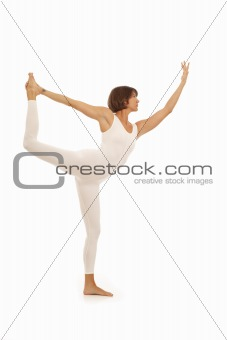Young woman doing yoga Dancer Pose
