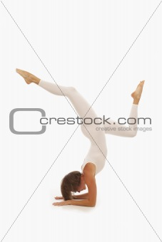 Young woman doing yoga Forearm Balance