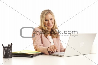 Young businesswoman with laptop at desk