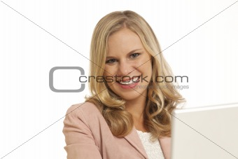 Close up portrait of young businesswoman with laptop at desk