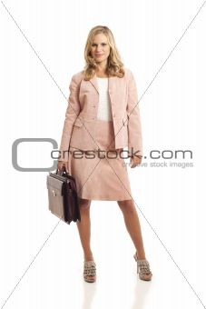 Young businesswoman standing with briefcase