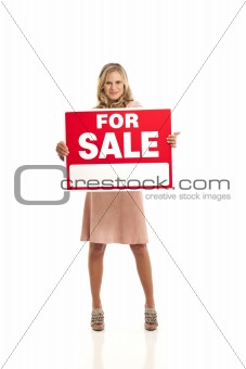Young businesswoman holding for sale sign