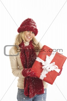 Portrait of young woman with red hat and gloves holding present
