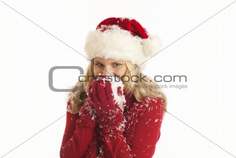 Young woman with Santa hat holding snow