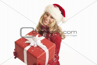 Young woman with Santa hat holding present