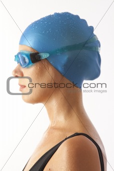 Close up portrait of young woman with swim cap and  swimming goggles