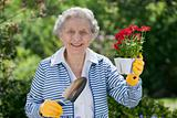 Smiling Senior Woman Holding Flowers