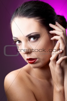 beautiful woman over color background