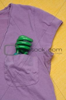 Green Compact Fluorescent Light Bulb in a Shirt Pocket