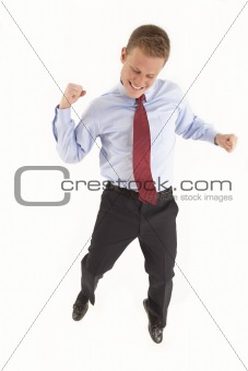 Smiling young businessman jumping in air with happiness