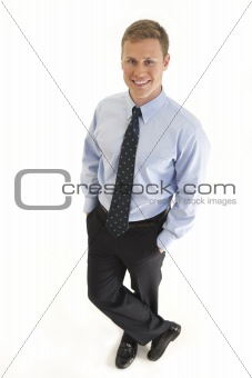 Portrait of smiling young businessman standing