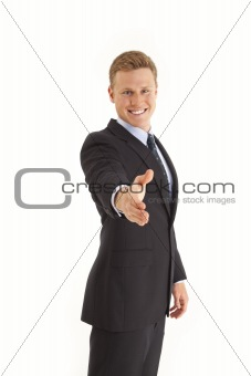 Portrait of young businessman with handshake